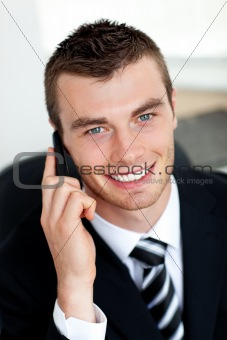 Smiling businessman using mobile phone