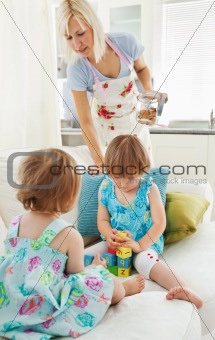 Woman playing with her daughters