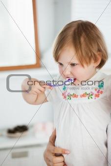 Small girl doing healthcare