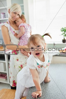 Attractive woman playing with her daughters