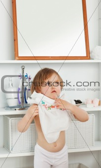 Small girl changing clothes