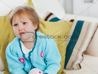 Small girl crying on sofa