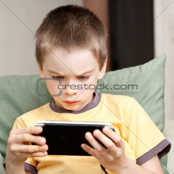 Boy playing game console