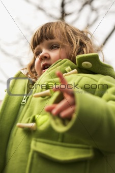 three year old girl outdoors in autumn