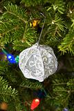 Christmas decorations on tree boughs