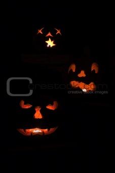 Three scary jack o'lanterns vertical