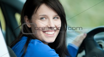 Bright female driver sitting in a car