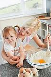 Mother and smiling child baking cookies 