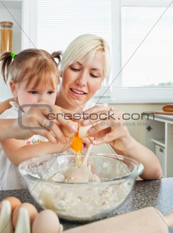 Relaxed mother and child baking cookies