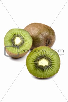 Cutting kiwi on white background