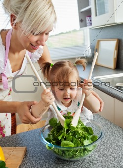 Bright mother and child cooking