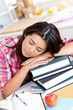Tired asian student sleeping on her books