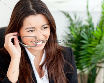Pretty businesswoman using headset