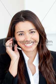 Confident asian businesswoman wearing headphones