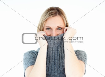 Cute young woman wearing a polo-neck sweater