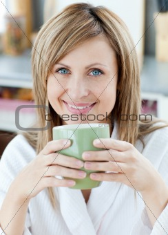 Charming woman drinking something