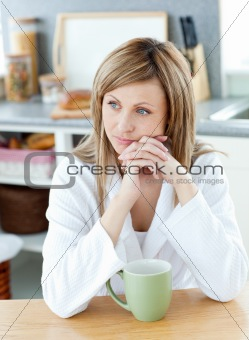 Thinking woman with a cup