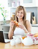 Green woman having breakfast