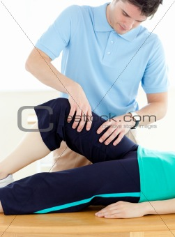 Young man doing fitness exercises with a patient