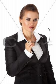 thoughtful modern business woman holding eyeglasses