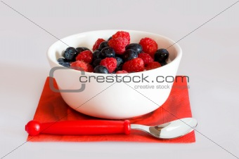 Bowl with berries on a white background