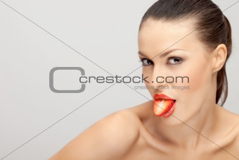 A Woman with a Strawberry in Her Mouth