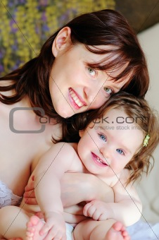 Beautiful mother and her baby-daughter close-up
