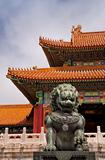 Beijing Forbidden City: lion against the corner of a roof.