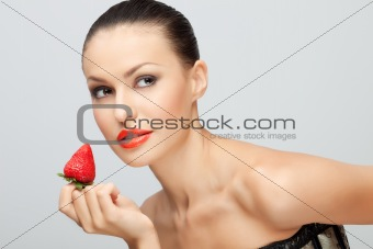 Young woman with strawberry.