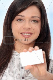 Beautiful businesswoman with business card