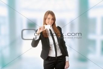 Beautiful young business woman with blank business card