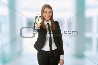 A young woman with alarm clock