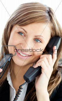 Attractive businesswoman talking on phone holding glasses