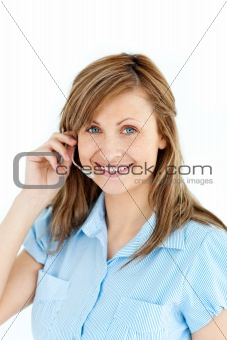 Charismatic caucasian businesswoman wearing headphones against white background