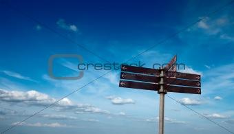 Blank signpost in sky