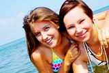 two women friends have a fun in sea