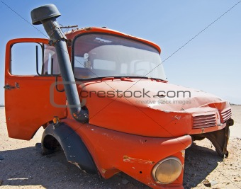 Abandoned lorry cab in the desert