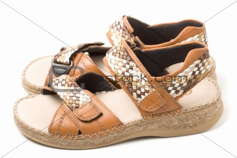 Pair of beige sandals isolated
