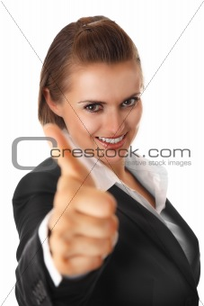 smiling modern business woman showing thumbs up gesture