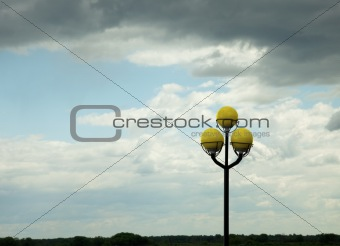 Ancient lamppost against evening sky