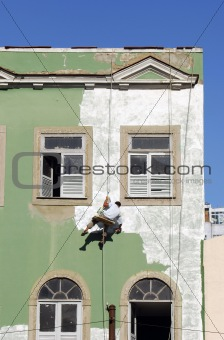 Painter hanged at a building´s façade