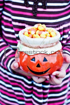 Child holding Halloween candy.