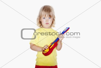 boy with long blond hair playing with toy guitar - isolated on white