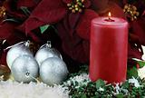 Christmas Candle and Poinsettias