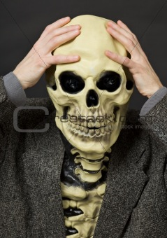 Amusing scared person in mask - skull