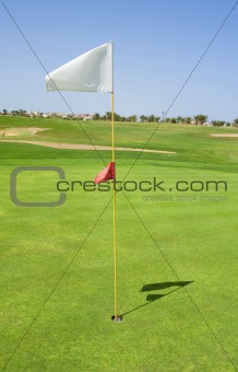 Flag on a golf course green