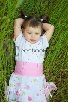Little girl has rest in grass