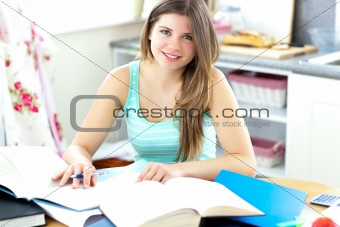 Captivating brunette student doing her homework