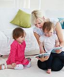 Small family reading a book