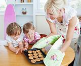 Pretty woman baking cookies with her daughter